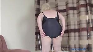 Taking off my black swimsuit